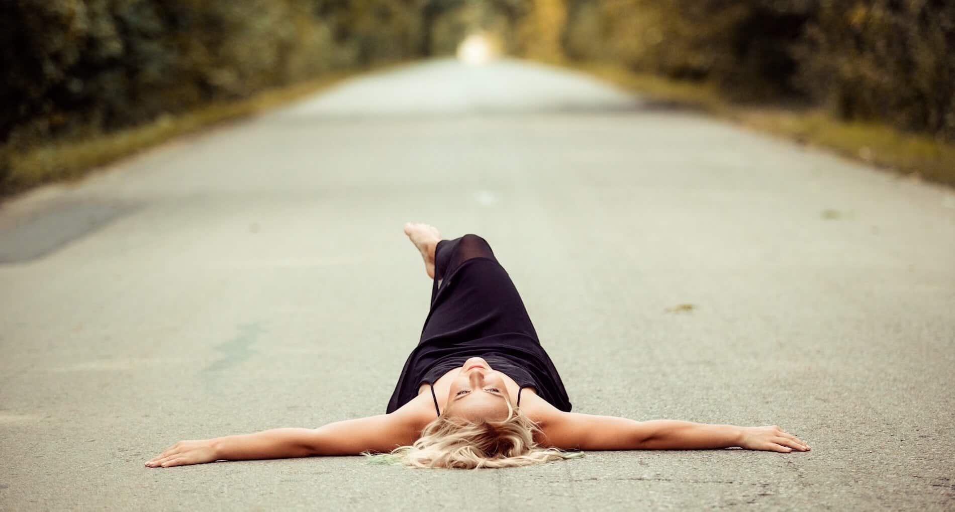 stressed girl relaxing in road